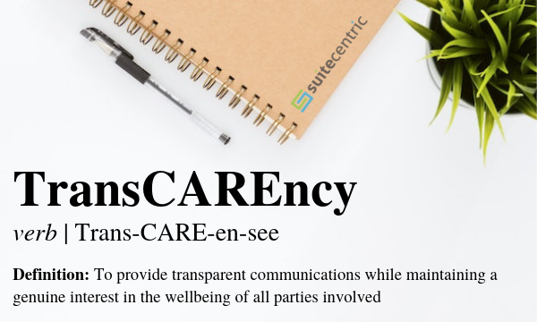 TransCAREncy text and definition next to pen, notebook and plant on a white surface
