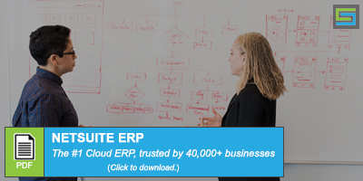 Two people writing on a dry erase board - Acumatica vs NetSuite - NetSuite ERP PDF