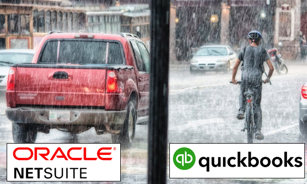 Red truck and bicyclist riding in the rain, NetSuite vs QuickBooks, NetSuite consultants