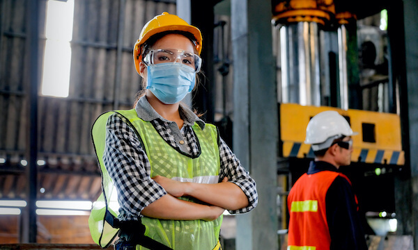 1 Woman with Mask and hardhat in manufacturing facility, NetSuite for Manufacturing
