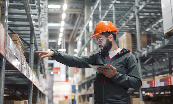Warehouse worker in front of shelving, sales tax changes